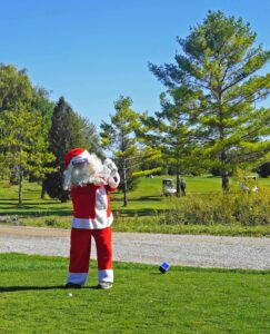 Santa playing golf at White Squirrel Golf course
